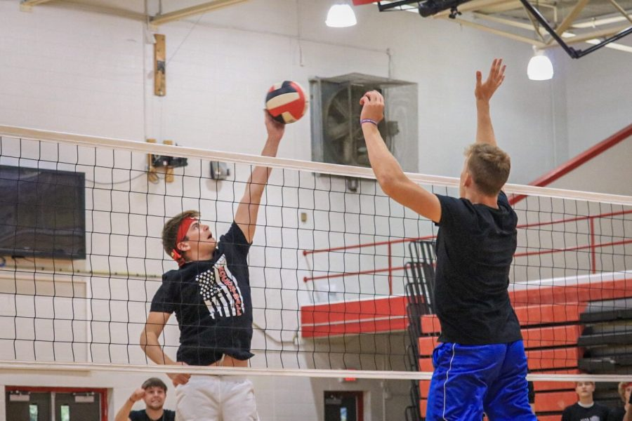 Senior Clay Prechtel scoring the final point against the juniors in the championship game. The seniors won the match in the third set and took home the trophy.