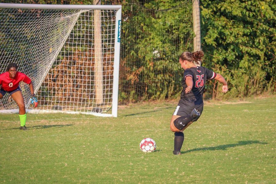 Senior captian Brooke Montauge scores during game against Butler.