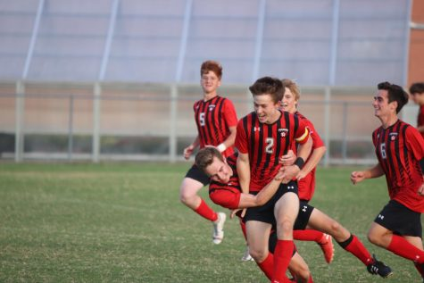 Zak Perdew (middle) and his teammates celebrating after Perdew scores the winning goal.