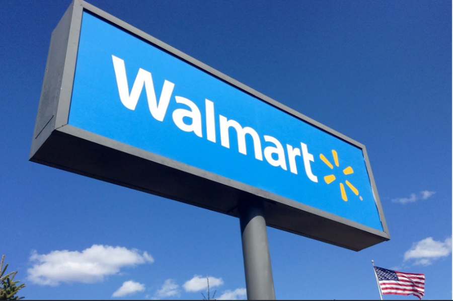 The Walmart sign in front of the American flag.