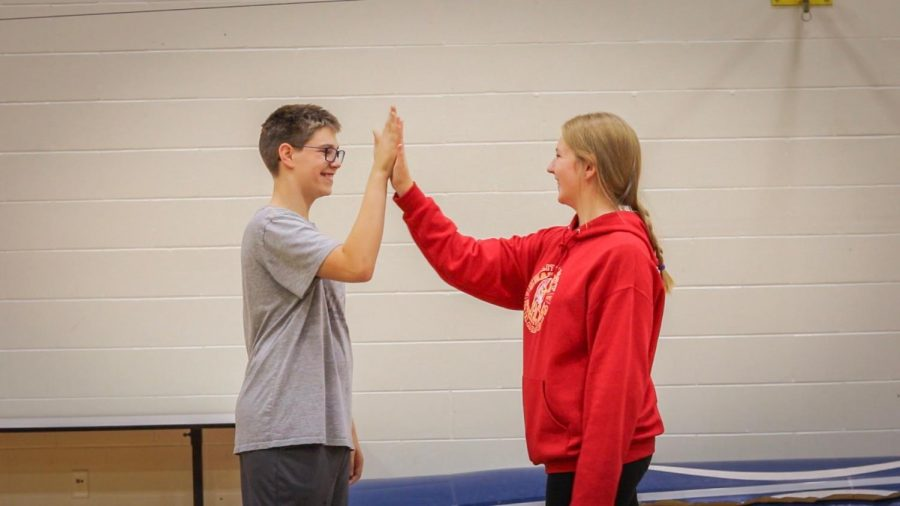 Haylie Lewis interacting with Cameron White during their adaptive PE class.