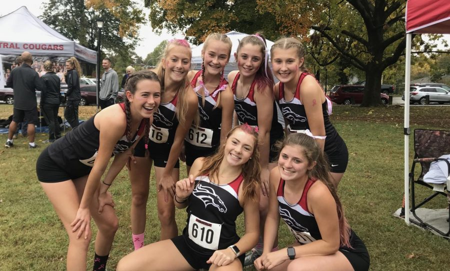 The girls on the cross country team pose after their meet. This is the second to last time they will run together as a whole on the season. All of the girls advanced to state.