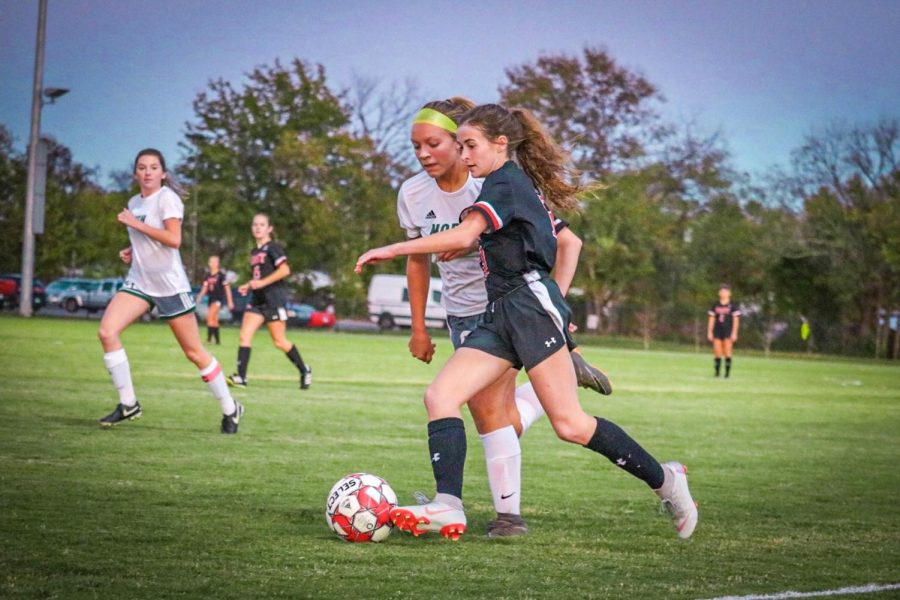 Junior Emma Wright moving the ball up the field. Wright was selected for the 6th Region All-Tournament Team.