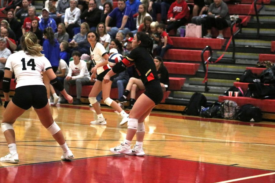 Senior Carly Morris passes the ball to a setter.