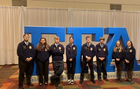 "The members from the Bullitt East and North Bullitt FFA chapters who attended the trip line up next to the FFA sign in the entrance of the convention. They were able to meet fellow FFA members and attend workshops to grow their leadership skills. ""The workshops that I attended while on the convention showed me how to stop outside of my box and talk to new people while also becoming a leader when needed,"" said junior Madi Wilhite."
