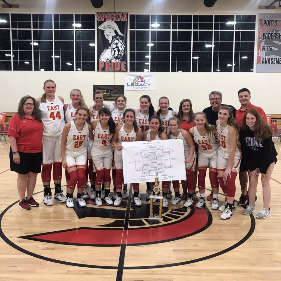The Lady Chargers pose next to their trophy after being titled the champions of the Tampa Bay Christmas Invitational. The girls played a total of three games, winning all three of them.