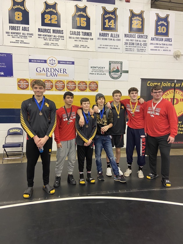 The wrestlers pose after the region three tournament. The team is sending seven wrestlers to state this coming weekend.