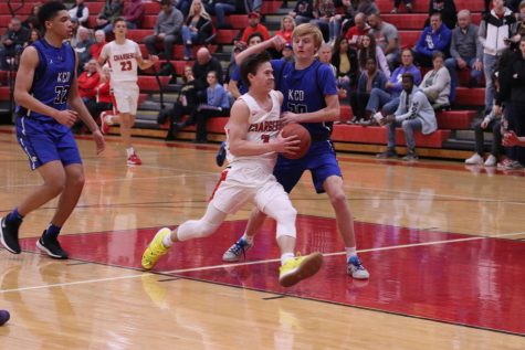 """Senior Zak Perdew drives the ball to the basket during the Kentucky Country Day game. The Chargers won this game 81-52. Maki said, """"It feels pretty good to win a few in a row. We we"""