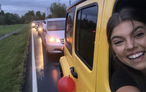 """Senior Meredith Bass, taking a selfie, in her car, at BE the Light. Apr. 23, 2020, an event was held where seniors, and their families, could go to Bullitt East, and drive around their high school one last time, and Bass went there. """"I was completely not expecting to be so emotional until the music came on, it added to everything and the teacher messages were amazing. It was really hard to see the baseball team so upset about their pregame song and jerseys hung up. I don't think it had really sunk in that i was going to be saying goodbye to BE, so when it hit it was really hard. It wasn't the send off we expected but our faculty and administrators really went above and beyond to make it special and I am so thankful for that,"""" said Bass, """"I would drive through it 1000 times. I love Bullitt East, and it was filled with everything I love about it."""""""