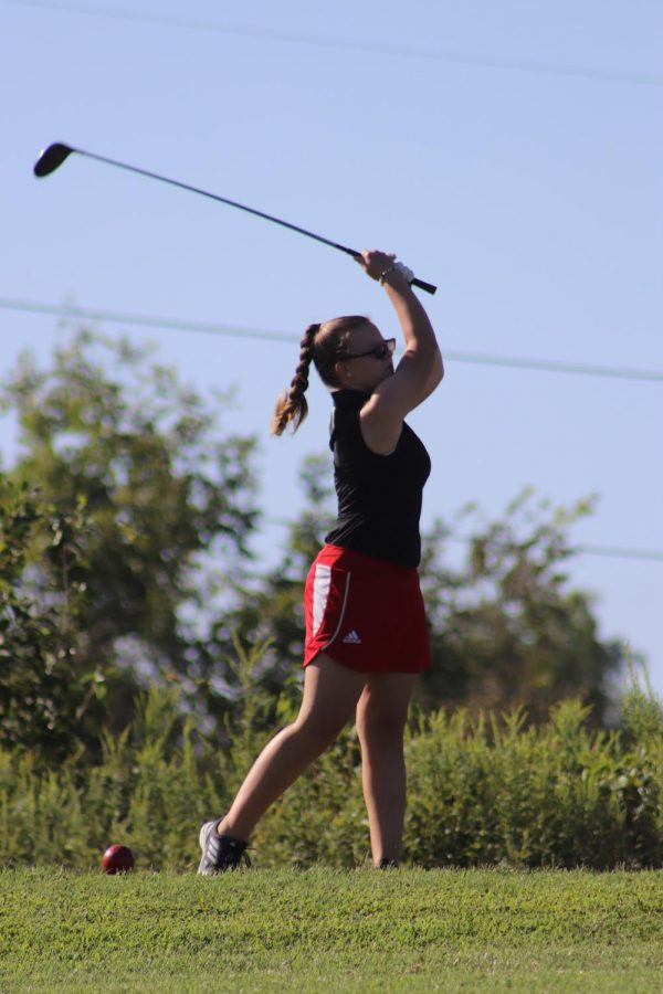 Junior Alayna Wells takes a swing down the course. Over the long offseason, she worked on her game and improved, but as a team, they could not make the advances they had hoped for due to COVID-19. Coach Larry Steinmetz said,