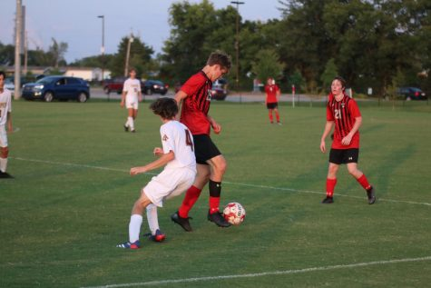 Senior Xavier Glauber taking the ball down the field.