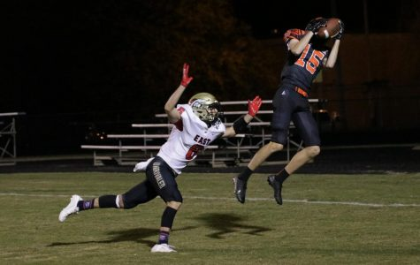 Senior Daniel Gilbert goes for the ball in the near end zone. Bullitt East let the game slip away from them with a few touchdowns in the game.