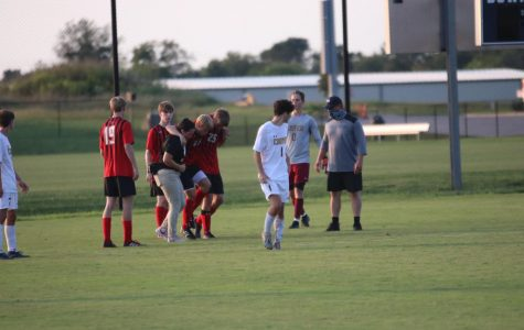 Sophomore Colin Elder gets carried off the field after season ending injury.