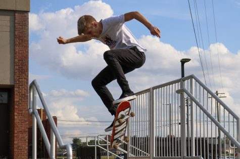 """Junior Daniel Biggs doing an ollie over a staircase. Biggs has been skateboarding for around ten months, and he enjoys doing many tricks, such as the kickflip, and the ollie. """"I enjoy skateboarding more myself, because I"""