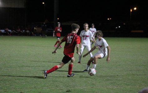 Landon Clark running the ball down the field.