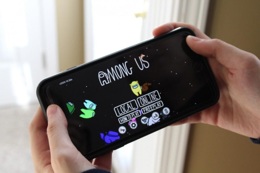 The among us homescreen, featuring the outer space setting and the characters from the game.