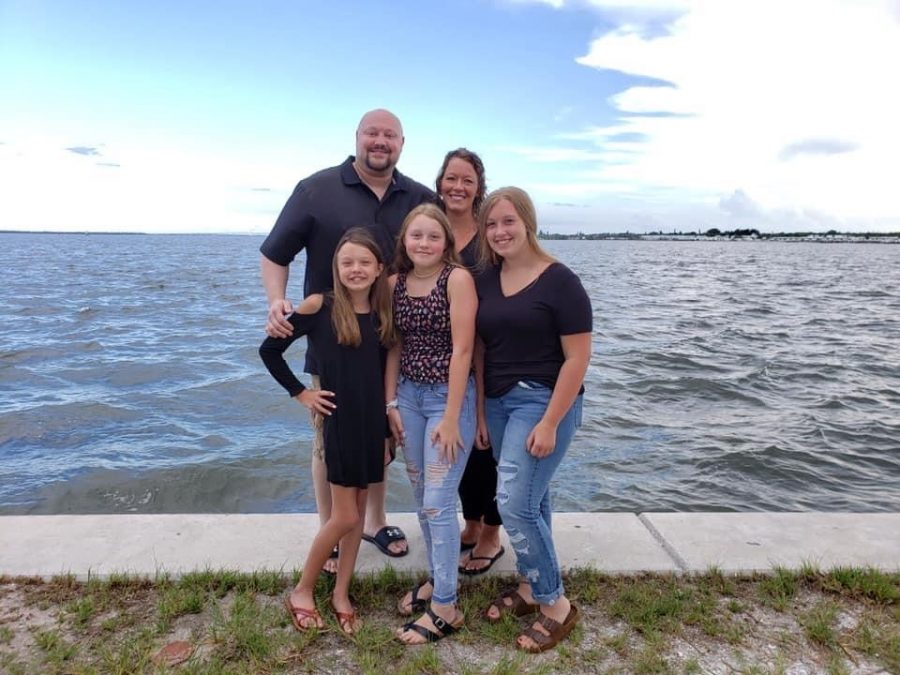 "In warm weather, taking family pictures on summer vacation by the ocean. Jacob wanted to have a big family vacation with his family before passing, while everyone was taking individual photos we snapped ours. ""I really had fun taking pictures and chasing everyone around, I will always remember this vacation,"" daughter Kailey Karner said."