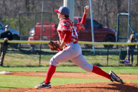"Senior Brock Hammond pitching a ball during their first game of the season. The first game of the season was a game against Christian Academy. ""It"