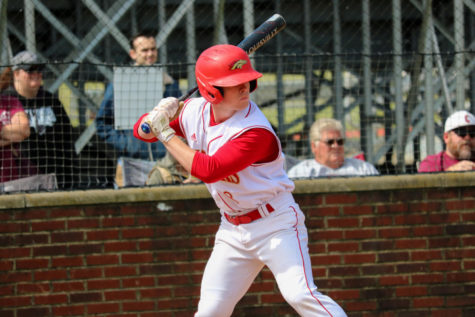 """Senior Slade Douthett getting ready to swing. Douthett was one of the main players of the May 8 game, against Bullitt Central, where they won 10-0, Bullitt East. """"I think we played very good Saturday, as a team. We knew going into the game, that this would be a must-win game, for us. For the most part, we made all of our plays, and hit the ball well,"""" Douthett said."""