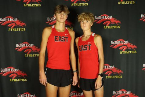 Some runners on the track team pose ahead of the season.