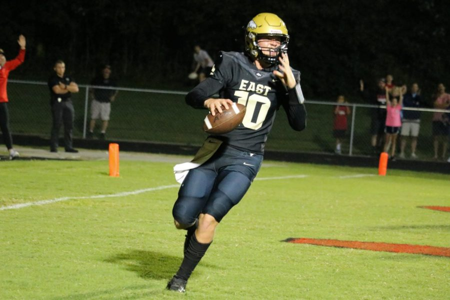 """Junior, and quarterback of the team, Travis Egan, after getting a touchdown. Bullitt East lost the Sept. 10 game against Graves County with a score of 48-46. """"I feel like we played good. We had to capitalize on a few things, but overall, weve come a long way, as a team,"""" Egan said, """"Converting on third downs, and just running the ball (was some of the highlights). We did pretty good on that."""""""