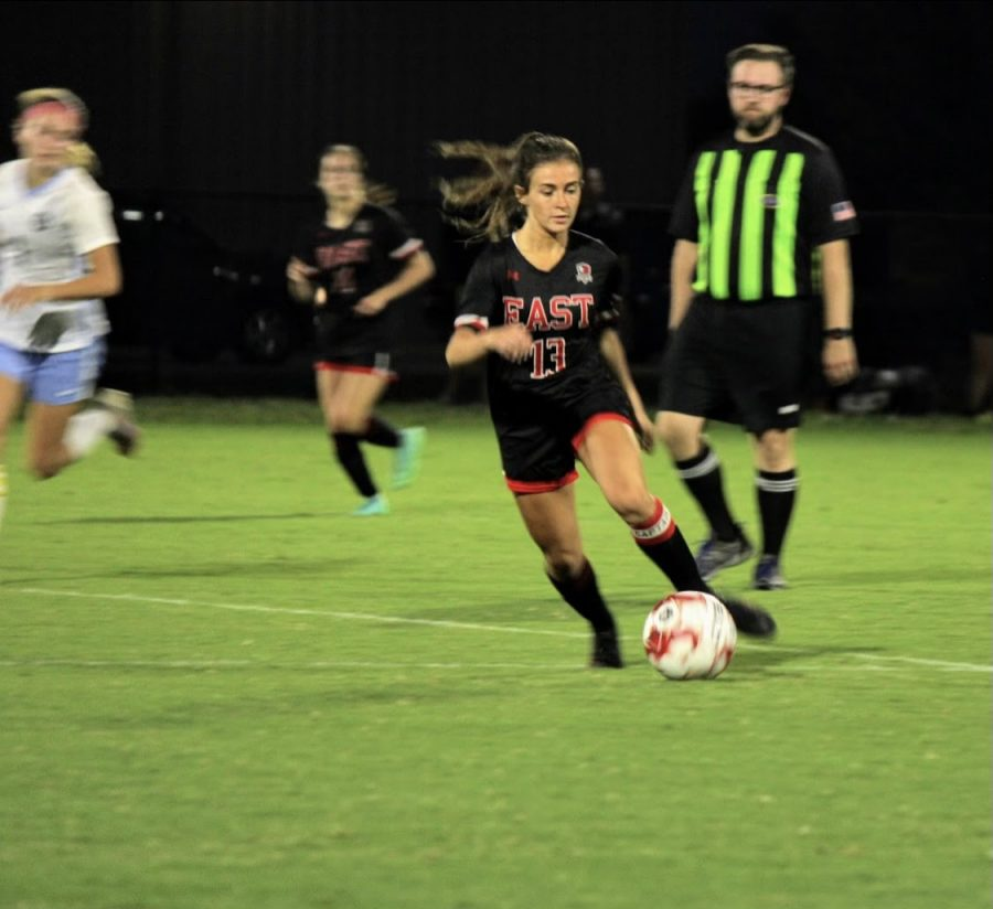 Senior Emma Wright dribbling the advancing the ball at thri last game against Mercy, Sept 27. Photo taken by Vicci Miles.